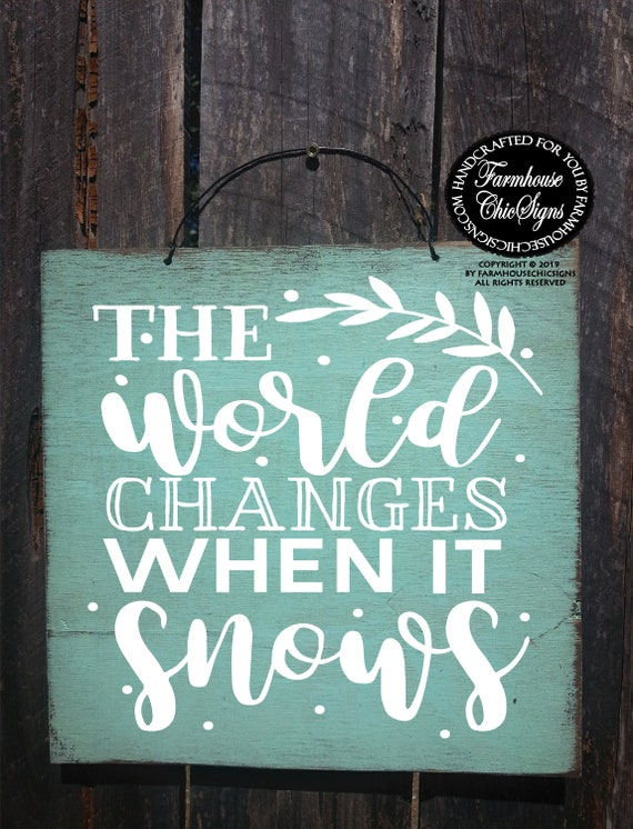 The World Changes When It Snows Rustic Sign