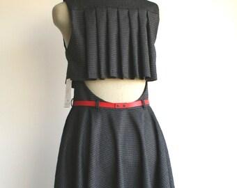 Dark grey dress, pleated back detail, circle skirt