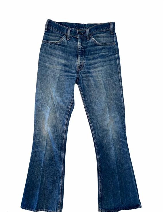 Vintage distressed orange tab 70s Levi's jeans