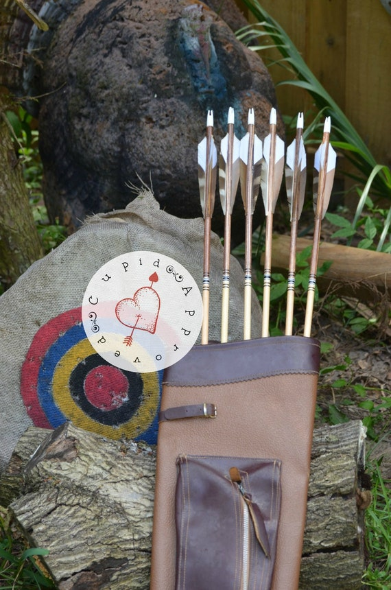 Archery arrows, wood arrows, brown, black and white arrows