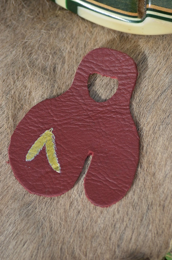 Archery shooting tab, red with gold feathers, left handed, size small