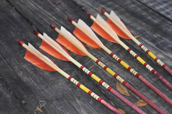 Archery arrows, wood arrows, yellow and red arrows