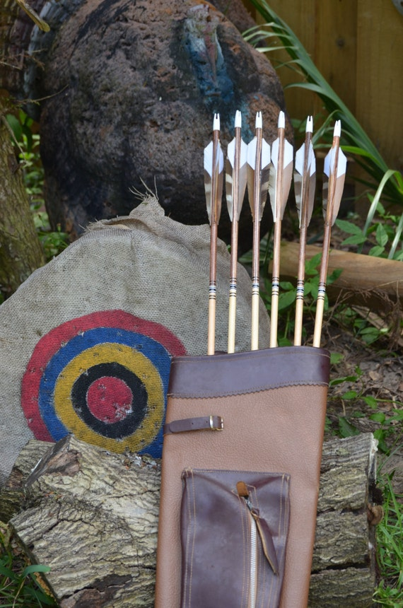 Archery arrows, wood arrows, brown, black and white arrows