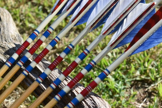 Archery arrows, wood arrows, Red, white and Blue arrows