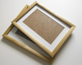Rusticdriftwood style frames in locally sourced,recycled wood in medium dark or very dark wax finish.To fit 7x5