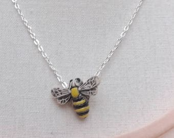 Bee pendant on a silver-plated chain. Ceramic bee necklace.