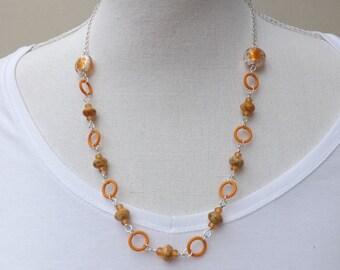 Orange hoops necklace with Czech glass beads, Miyuki beads, and chain