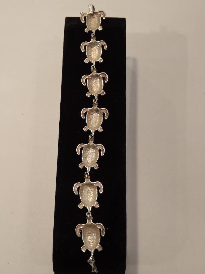 ETSY sale item--BRACELET size 8,security clasp.circa 1990/'s Sterling silver #925 7 large Turtles diamond facet cut SEALIFE