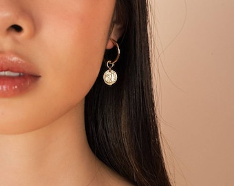 Exeter earrings.Hoops. Coin. Dangling earrings. Gold. Fashion. Women. Gifts for her. Minimalist. Casual. Jewelry. Accessories. Earrings.