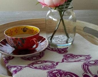 Firenze design screen printed linen tea-towel in magenta.