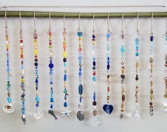 Beaded curtain, window, wall, palm tree, alligators, dolphin, sea shells, boat, prism, rainbow, bead curtain, flip flop, beach, sun catcher