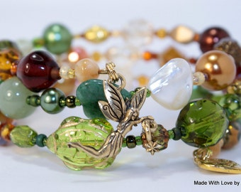 Wooded Forest Creatures, Fairy Beaded Wrap Bracelet, Gold plated Fairy charm,  Golden tones with forest greenery and pearl accents
