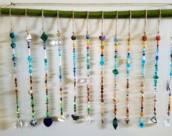 Beaded curtain, window, palm tree, sand bucket, turtle, sea shells, dragonfly, prism, rainbow, flip flop, beach, sun catcher, bead curtain