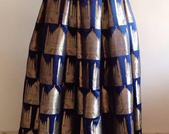 Navy blue brocade box pleat skirt with Taj Mahal design. Custom colors available