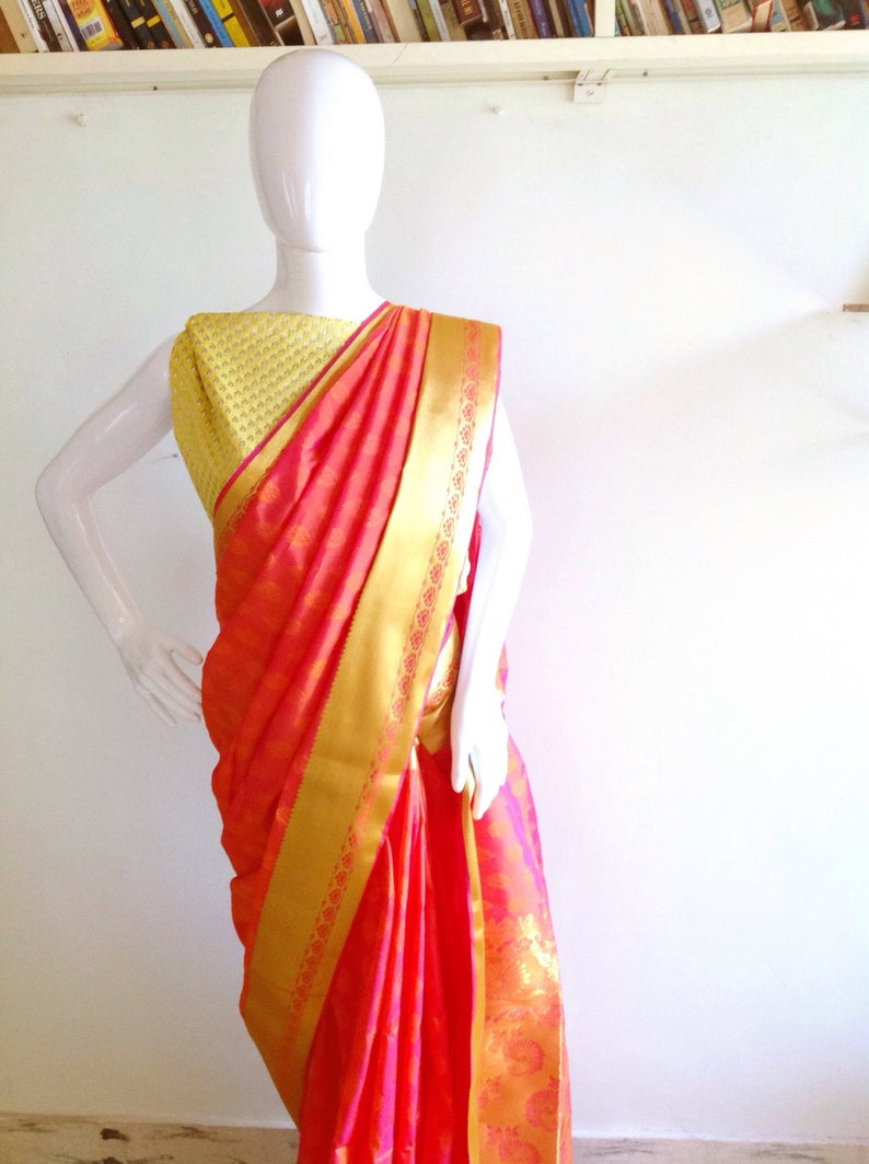d693f3895a5942 Art silk saree with woven zari border paired with a lime green