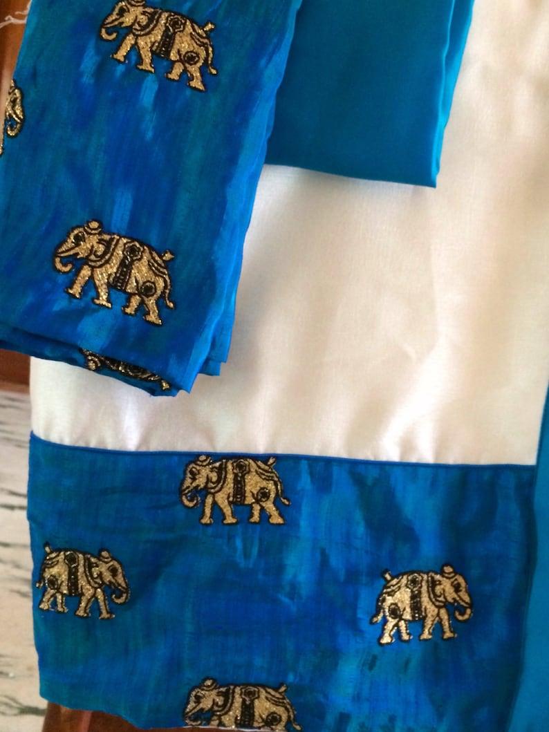 e1f08635a4b771 White semi silk saree with embroidered elephant border in