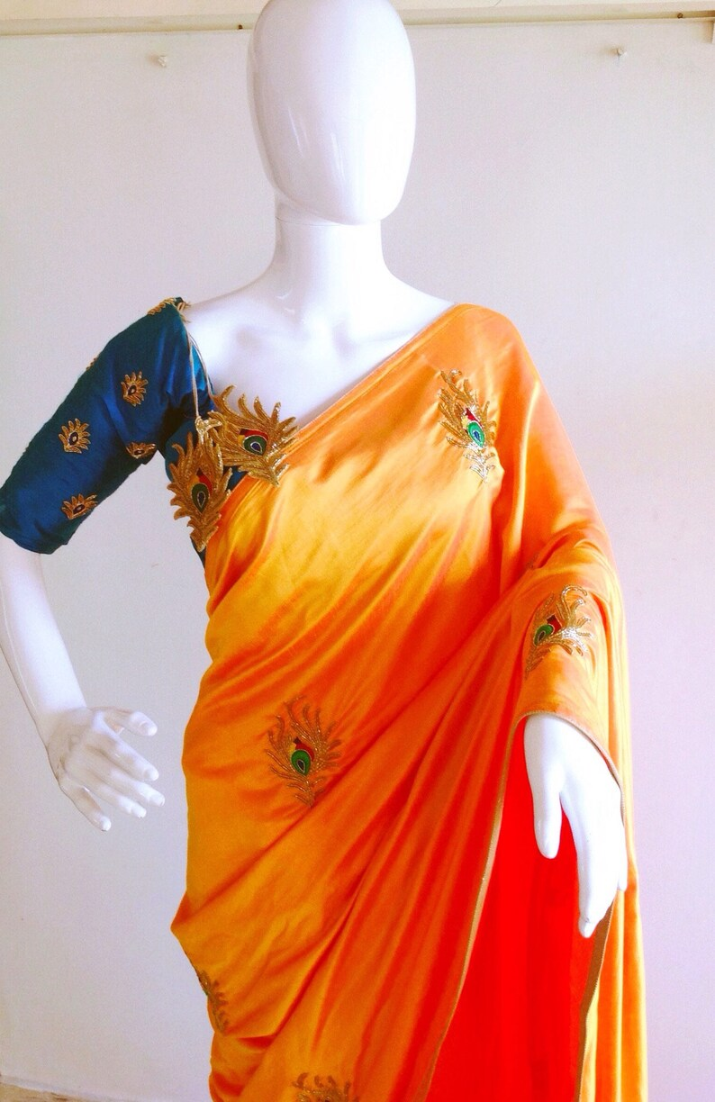 4c806af4ea83bf Orange semi raw silk saree with hand embroidered peacock and