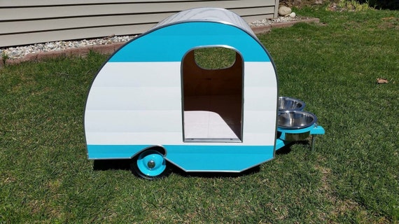 Vintage style doghouse trailer camper with wings