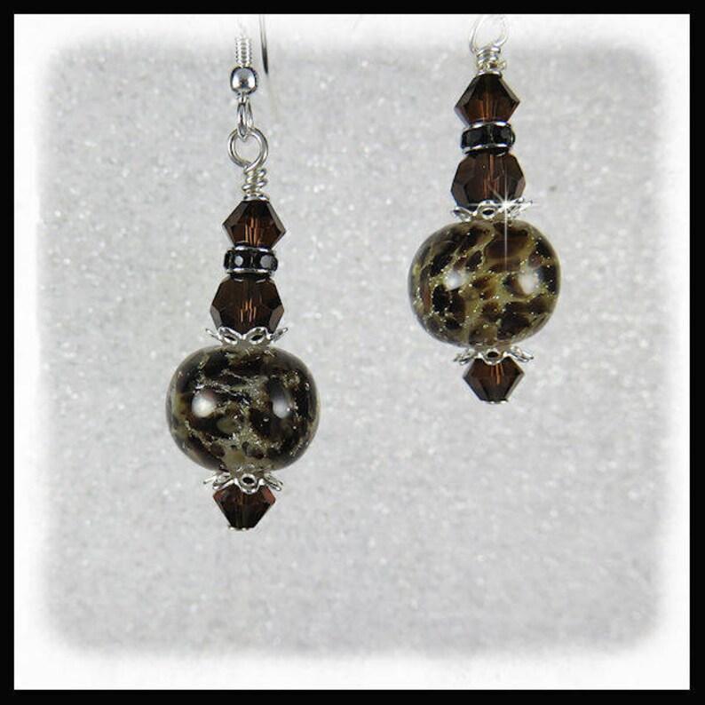 2265 Animal print lampwork glass earrings brown and black image 0