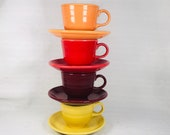 Fiesta Teacups And Matching Saucers Multi Colored