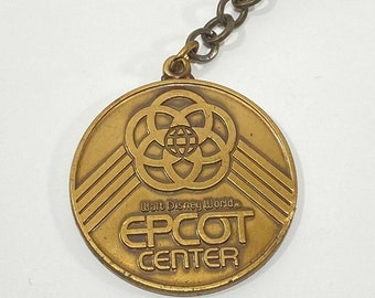Epcot Center KEYCHAIN with Spaceship Earth, Unity Logo and 6 Pavilions on the back from 1982 EPCOT - Bronze, Metal, Grand Opening, Coin, Med