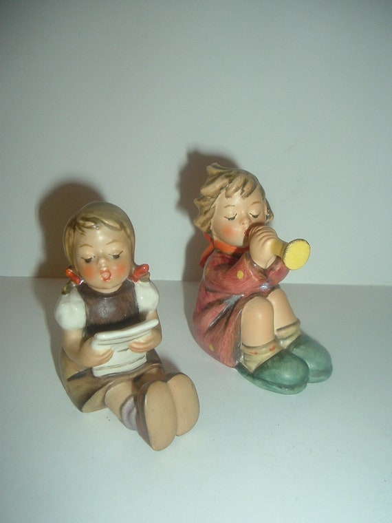 Hummel HUM 391 Girl with Trumpet & 389 Girl Sitting with Music Singing Figurines