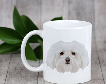 Enjoying a cup with my pup Bolognese- a mug with a geometric dog