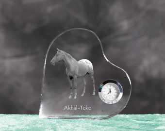 Akhal-Teke- crystal clock in the shape of a heart with the image of a pure-bred horse.