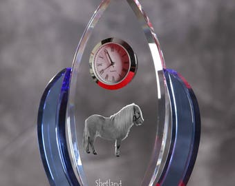 Shetland pony-   crystal clock in the shape of a wings with the image of a pure-bred horse.