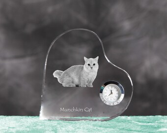 Munchkin- crystal clock in the shape of a heart with the image of a pure-bred cat.