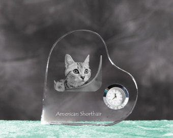 American shorthair- crystal clock in the shape of a heart with the image of a pure-bred cat.