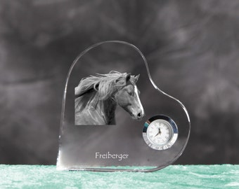 Freiberger- crystal clock in the shape of a heart with the image of a pure-bred horse.