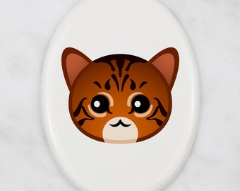 A ceramic tombstone plaque with a Toyger cat. Art-Dog cute cat
