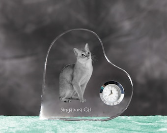 Singapura cat- crystal clock in the shape of a heart with the image of a pure-bred cat.
