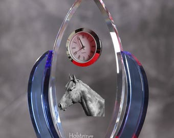 Holsteiner-   crystal clock in the shape of a wings with the image of a pure-bred horse.