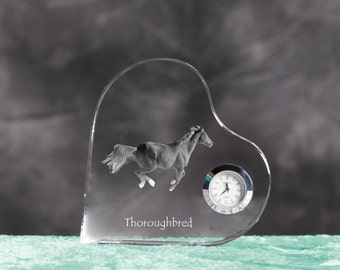 Thoroughbred- crystal clock in the shape of a heart with the image of a pure-bred horse.