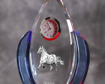 Noriker-   crystal clock in the shape of a wings with the image of a pure-bred horse.