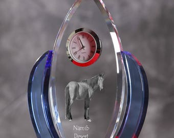 Namib Desert Horse-   crystal clock in the shape of a wings with the image of a pure-bred horse.