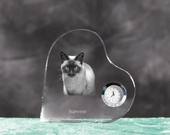 Siamese cat - crystal clock in the shape of a heart with the image of a pure-bred cat.