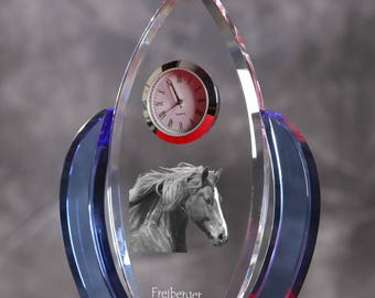 Freiberger-   crystal clock in the shape of a wings with the image of a pure-bred horse.