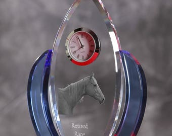 Retired Race Horse-   crystal clock in the shape of a wings with the image of a pure-bred horse.