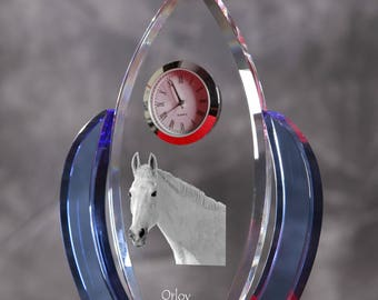 Orlov Trotter-   crystal clock in the shape of a wings with the image of a pure-bred horse.