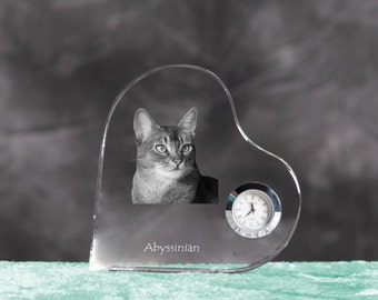 Abyssinian cat - crystal clock in the shape of a heart with the image of a pure-bred cat.