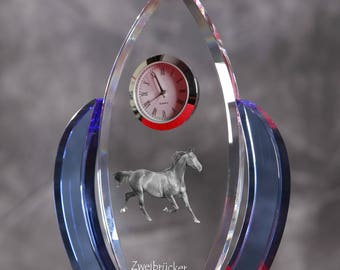 Zweibrücker-   crystal clock in the shape of a wings with the image of a pure-bred horse.