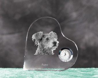 Pumi- crystal clock in the shape of a heart with the image of a pure-bred dog.