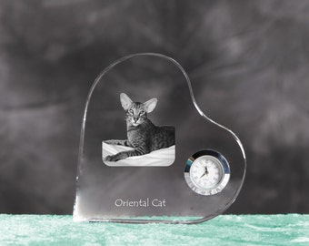 Oriental cat- crystal clock in the shape of a heart with the image of a pure-bred cat.