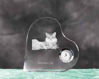 Siberian cat- crystal clock in the shape of a heart with the image of a pure-bred cat.