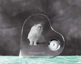 Himalayan cat- crystal clock in the shape of a heart with the image of a pure-bred cat.