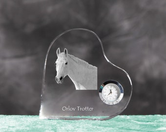 Orlov Trotter- crystal clock in the shape of a heart with the image of a pure-bred horse.