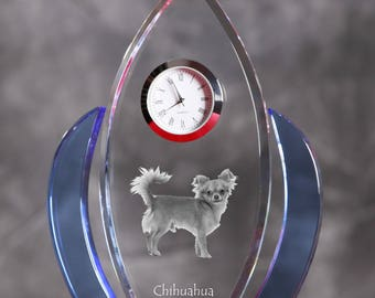 Chihuahua- crystal clock in the shape of a wings with the image of a pure-bred dog.